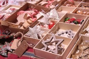Handmade Christmas decorations exposed in wooden boxes on advent market stall